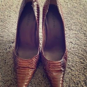 Pointed snakeskin heels  closed toe